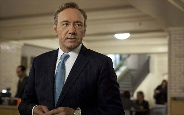 Kevin Spacey as Francis Underwood in navy pinstripe.