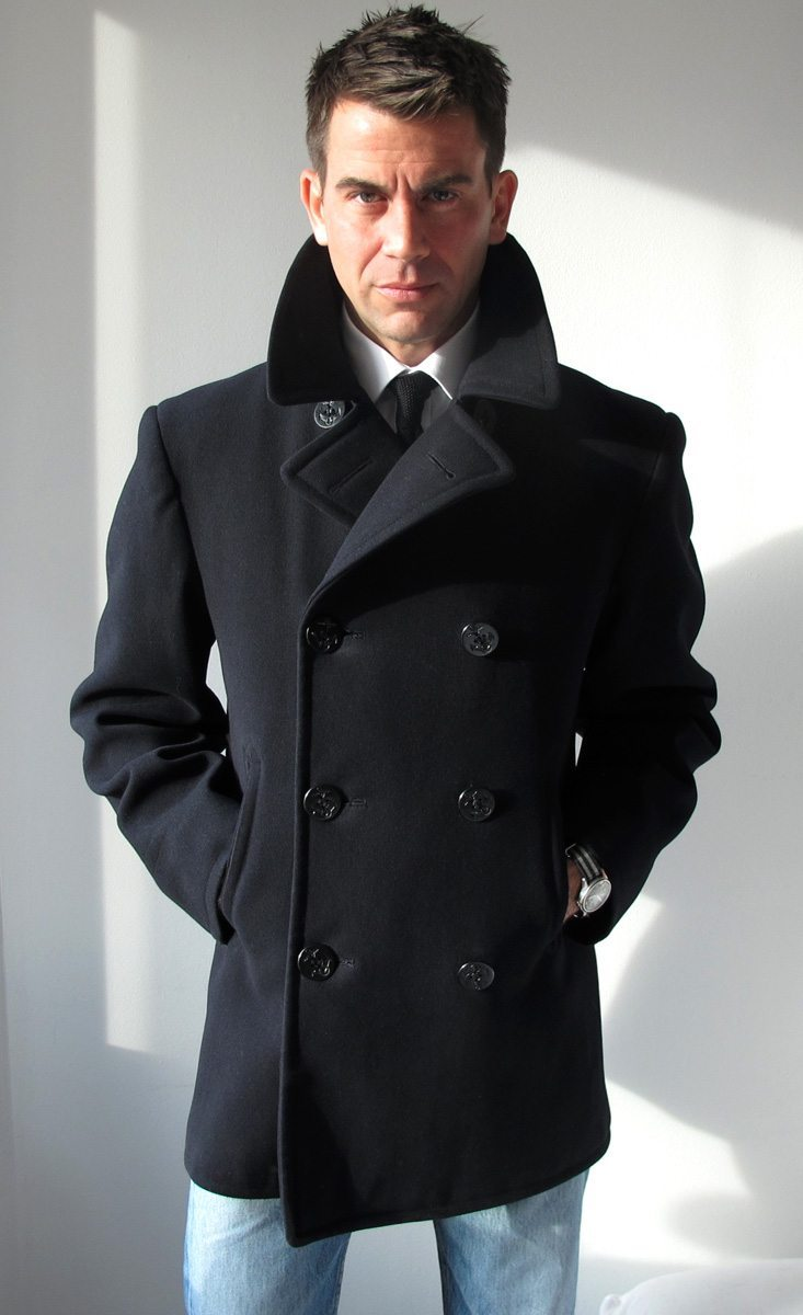 A pea coat (or pea jacket, pilot jacket) is an outer coat, generally of a navy-coloured heavy wool, originally worn by sailors of European and later American navies. Pea coats are characterized by short length, broad lapels, double-breasted fronts, often large wooden, metal or .
