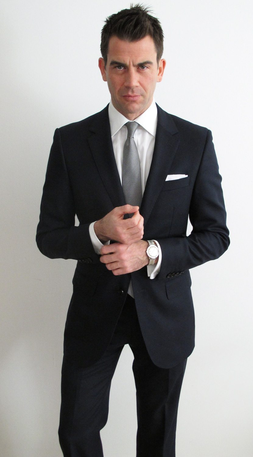 Whether it 39 s your only suit or the first of many go navy for Navy suit black shirt
