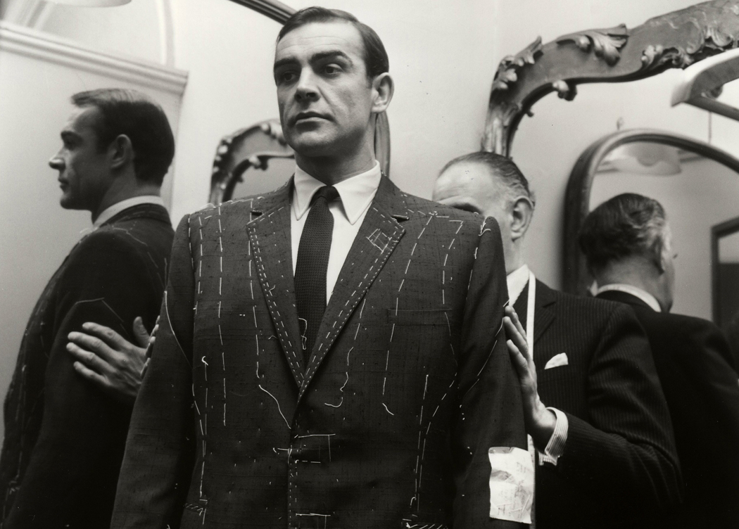 Sean Connery getting properly suited by Anthony Sinclair in London. (Photo by Harry Myers / Rex Features)