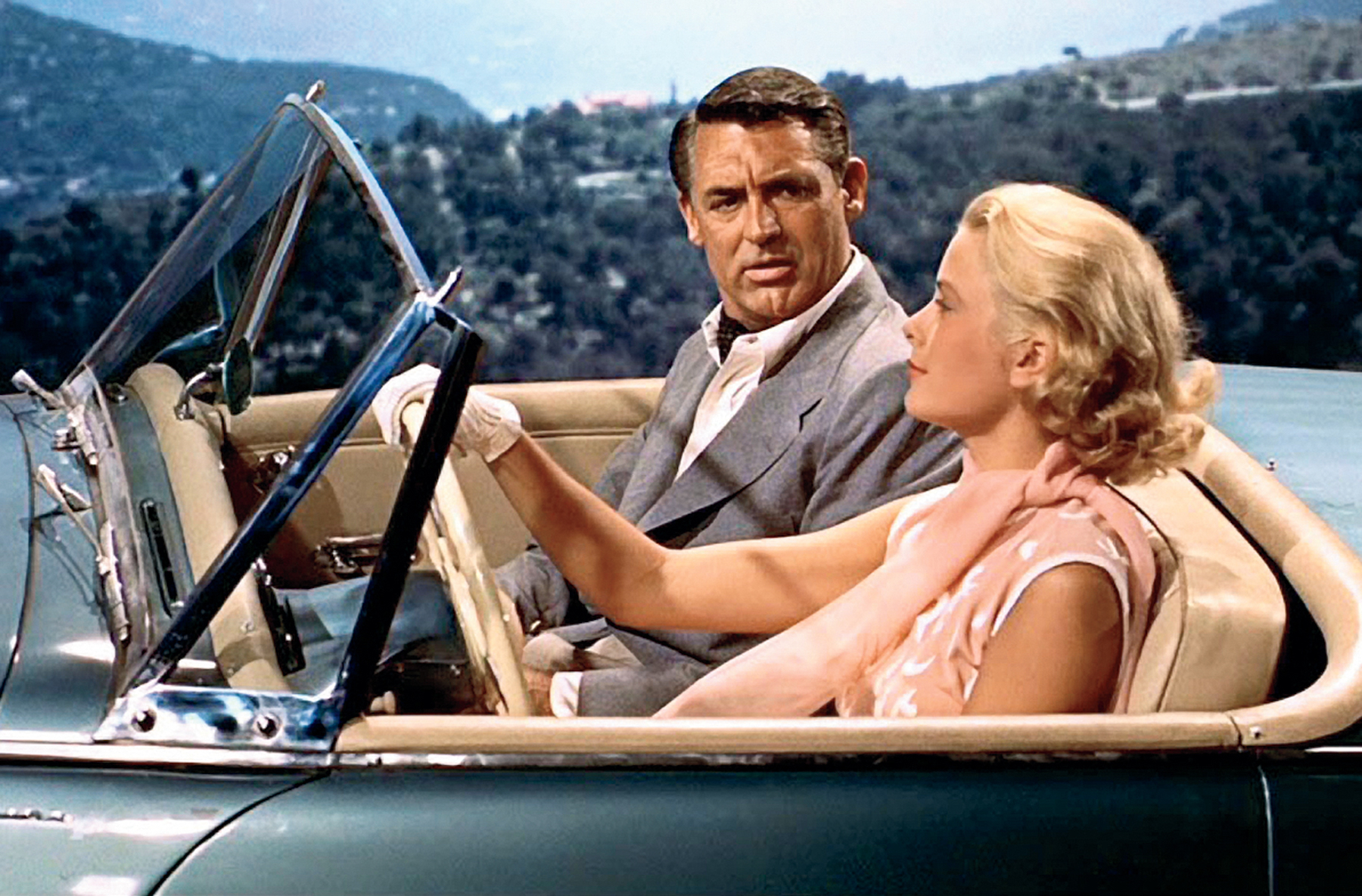 Off to a picnic lunch with Grace Kelly at the wheel of her Sunbeam Alpine Series III convertible.